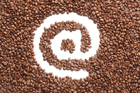 photo shot of email symbol made from coffee beans photo