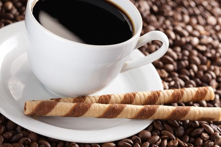 the photo shot of coffee rolls and cup Stock Photo