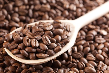 the coffee beans on wooden spoon photo