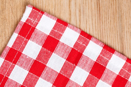 white blanket: the checkered tablecloth on wooden table