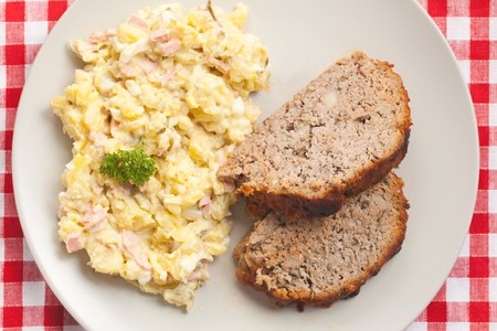 photo shot of baked meatloaf with potato salad photo