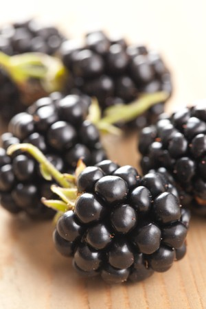 photo shot of blackberries on wooden table photo