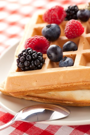 photo shot of tasty waffle with fruits photo