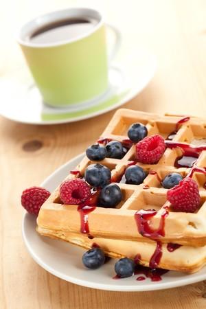 photo shot of tasty waffle with fruits photo