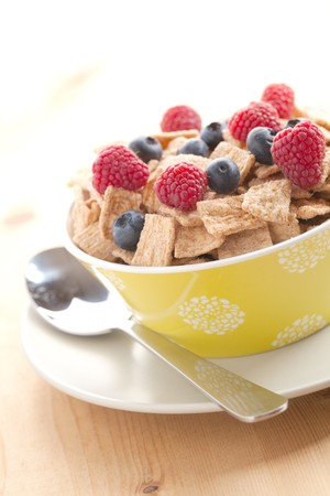 photo shot of cinnamon cereals with fruits photo