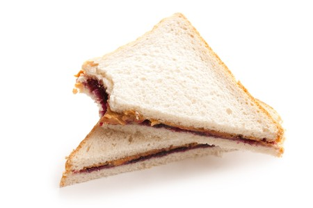 jam sandwich: photo shot of peanut butter and jelly sandwich