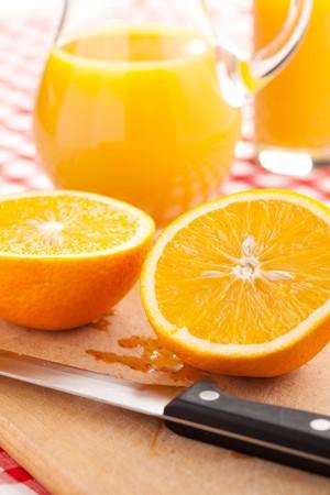 orange juice and orange fruit on wooden table photo