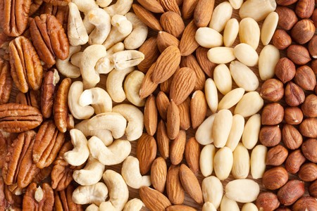 photo shot of various nuts on background photo