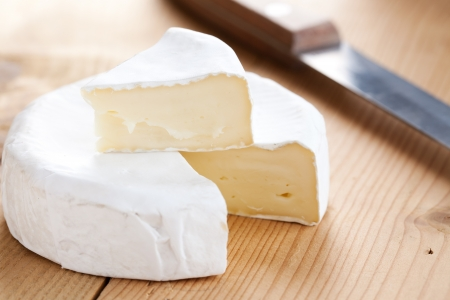 cheese knife: photo shot of brie cheese Stock Photo