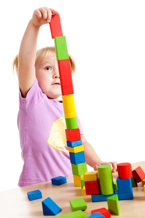 studio shot of little girl playing with toy blocks photo