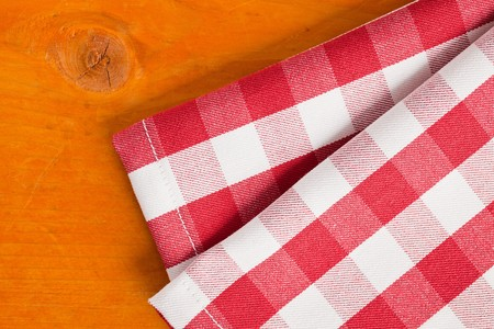 checkered napkin on wooden table photo