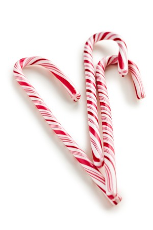 stripy candy cane on white background Stock Photo - 7898619