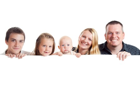 studio shot of happy family behind white board Stock Photo - 8006933