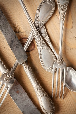 vintage cutlery: the old cutlery on wooden table Stock Photo