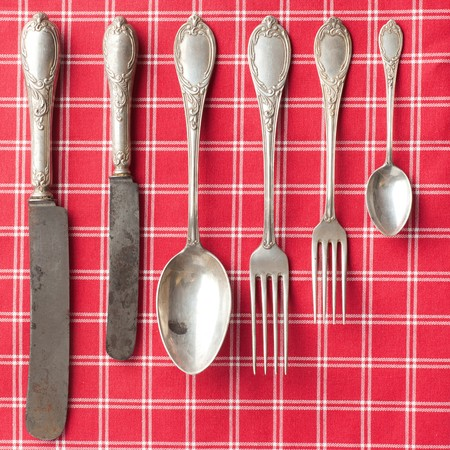 vintage cutlery: the old cutlery on checkered tablecloth