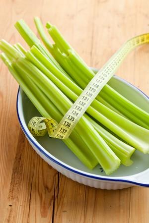 green celery sticks on kitchen table photo