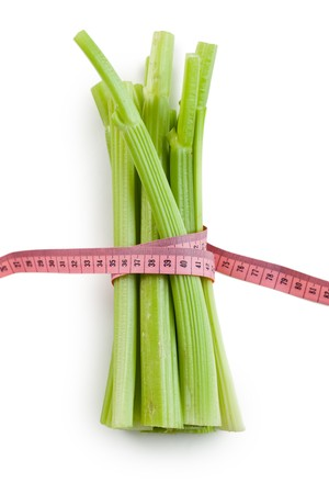 green celery sticks on white background photo