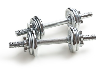 chrome dumbells on white background photo