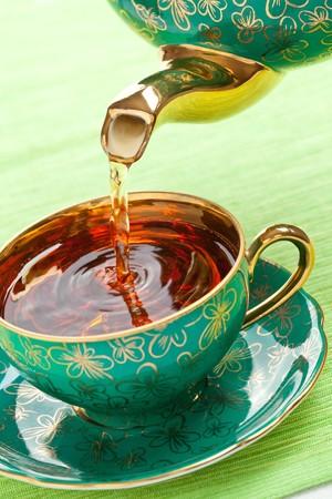 the tea in antique porcelain mug photo