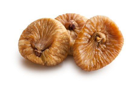 dried food: dried figs on white background
