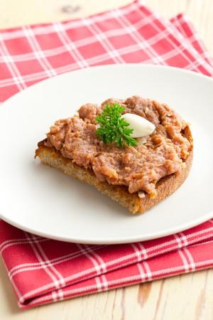 steak tartare:  roasted bread with steak tartare
