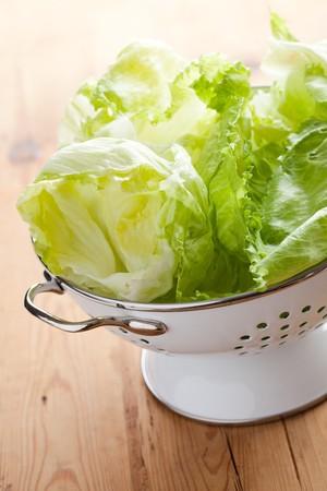 a colander: green lettuce in colander Stock Photo