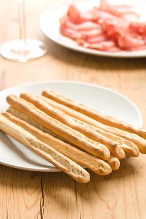 grissini: grissini sticks on wooden table Stock Photo