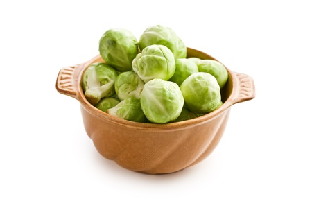 brussels sprouts in bowl on white background photo