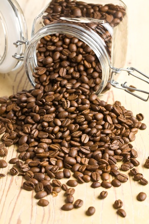 poured coffee beans from a jar photo