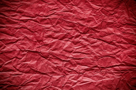 creased: the red crumpled paper background