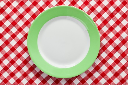 the green plate on checkered tablecloth Stock Photo - 8409010