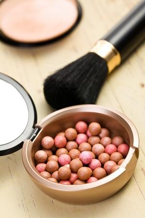 the bronzing pearls and makeup brush photo