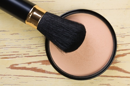 the makeup brush and cosmetic powder compact  photo