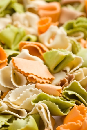 the raw colored pasta background photo