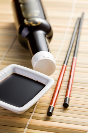 glass containers: the photo shot of soy sauce and chopsticks Stock Photo