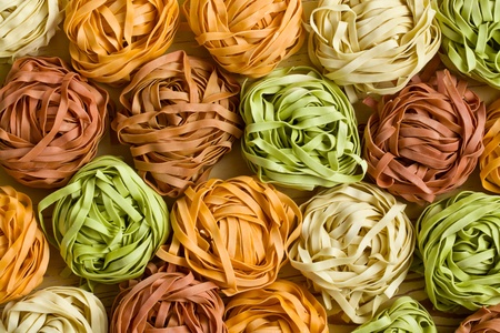 carbohydrates food: colorful pasta tagliatelle