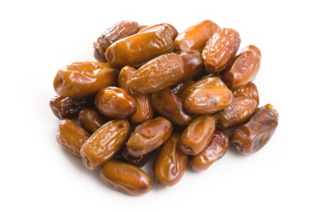 dried dates on white background photo