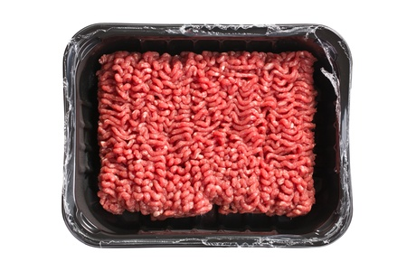 mincing: raw minced meat on white background