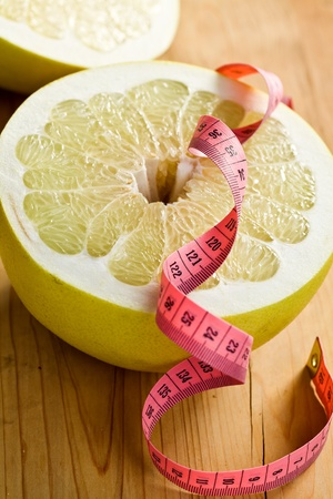 freshest: dieting . pomelo fruit on kitchen table Stock Photo