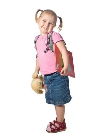 ni�o con mochila: un ni�o peque�o con un libro Foto de archivo