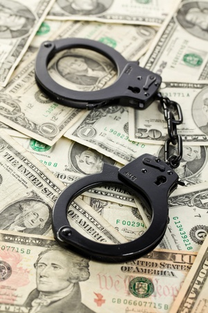 the handcuffs on dollars on american money Stock Photo - 8809539