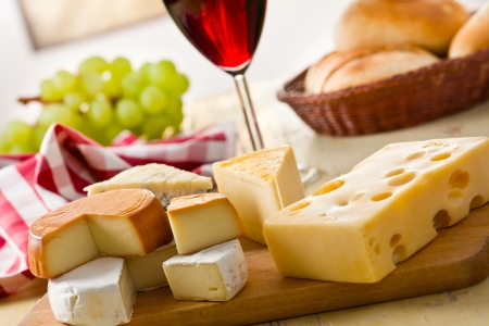 cheese knife: the still life with cheeses Stock Photo