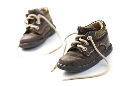 children's wear: kids leather shoes on white background Stock Photo
