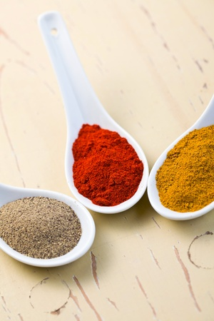 various spicy powder on wooden table Stock Photo - 8809609