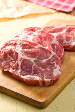 raw juicy meat on wooden table photo