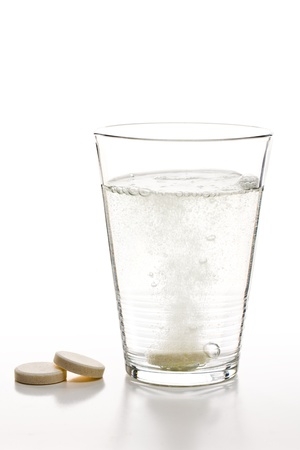 the effervescent tablets and glass with water photo