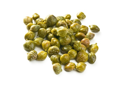 capers: green capers on white background Stock Photo
