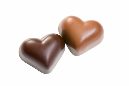 chocolate hearts on white background photo