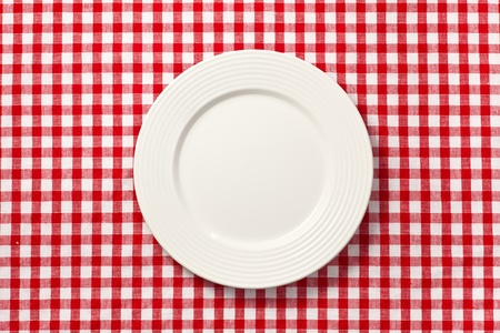 the white plate on checkered tablecloth photo