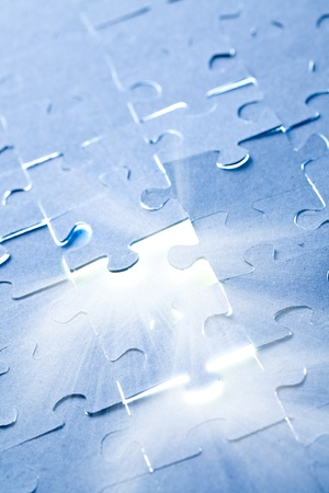 the jigsaw puzzle with white light Stock Photo - 9122353